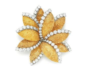 A gold and diamond brooch by Van Cleef- Arpels