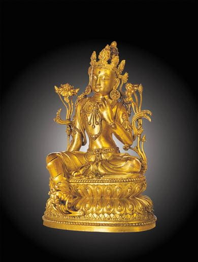A rare and superbly cast gilt-bronze figure of avalokiteshvara, China, Ming dynasty, Yongle six-character mark inscribed in a line and of the period (1403-1425). Courtesy, Christie's.