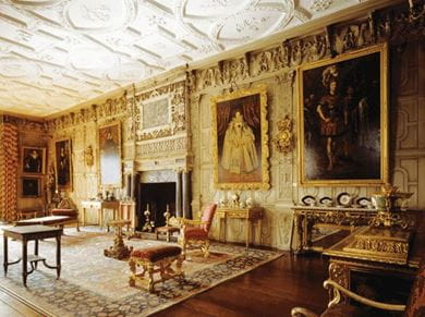 View of the ballroom, at Knole, Sevenoaks, Kent in England, featuring a decorative chimney piece, gilded furniture and plasterwork ceiling