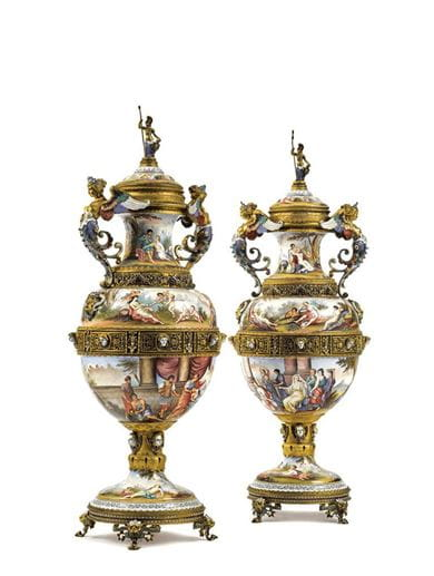 A pair of Austrian gilt-metal and enamel large two-handled vases and covers, late 19th century. Courtesy Sotheby's