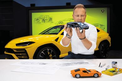 Mitja Borkert head of design at Automobili Lamborghini examines a scale model