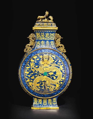A  gold and silver decorated blue enamel ground moon flask and cover, 1736-1795, courtesy Christie's