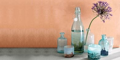 Give party supplies a homely touch with printed decals wrapped around pale glass bottles
