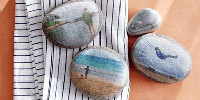 Create and use decoupaged rocks to weight down napkins and tablecloths on breezy days