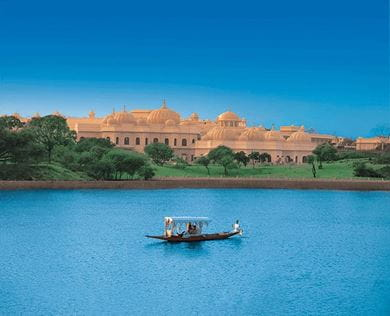 Shikara boat for guest transfers at The Oberoi Udaivilas, Udaipur