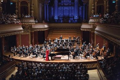 Pianist Khatia Buniatishvili is applauded for her performance with the UN Orchestra conducted by Antoine Marguier in aid of Syrian refugees at the Victoria Hall