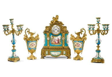 An associated Louis XVI style gilt bronze and Sèvres style ceramic five piece clock garniture, Paris, 1895. Courtesy, Sotheby's