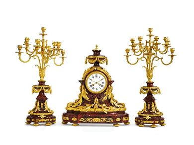 A Louis XVI style gilt bronze mounted rouge griotte marble clock garniture, Paris, 19th century. Courtesy, Sotheby's.