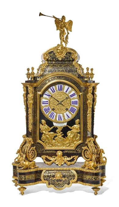 A Louis XIV ormolu mounted tortoiseshell and brass Boulle-inlaid table clock by Pierre Du Chesne, Paris, circa 1705. Courtesy, Sotheby's