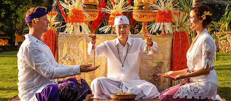 Experience Balinese Hindu Ceremony to Renew Your Marriage Vows Draped in Balinese Costumes by The Beach - The Oberoi, Bali