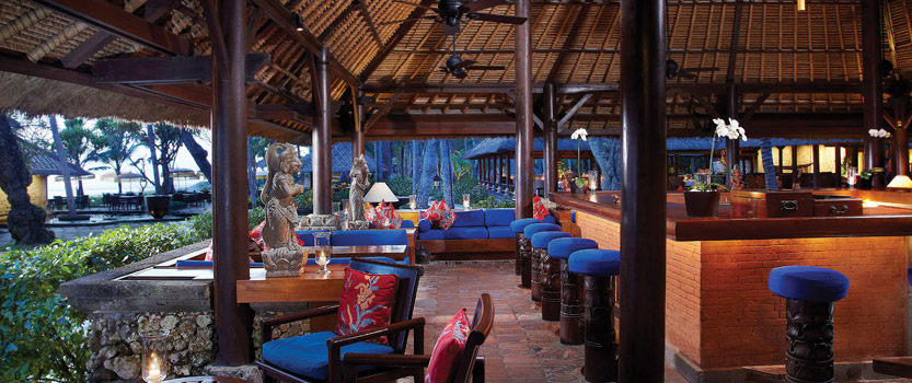 Kayu Bar Under Traditional Thatched Roof, Furnished With Wooden Carvings & Artifacts at The Oberoi, Bali