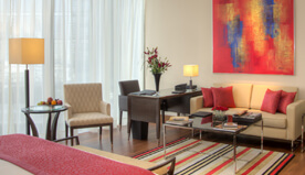 Decorated in Natural Palettes & Modern Artworks are The Deluxe Suites With Private Balcony at The Oberoi, Dubai