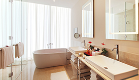 Luxury Bathrooms With Walk-In Wardrobe & Standalone Bathtub & Views of The City in The Two Bedroom Family Suite at The Oberoi, Dubai