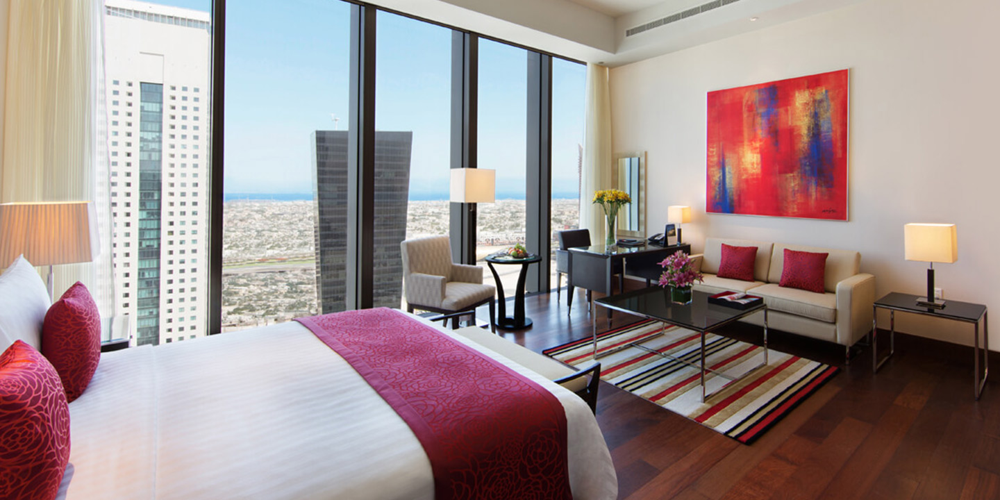 Two or Three Bedroom Family Suite, Dining, & Personal Bar at The Oberoi, Dubai