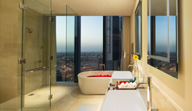 Luxury Bathrooms With Walk-In Wardrobe & Standalone Bathtub & Views of The City in The Luxury Suite at The Oberoi, Dubai