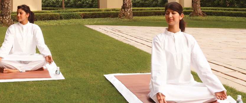 Learn The Ancient Healing Power of Yoga in The Gardens or in a Private Session at The Oberoi, Gurgaon