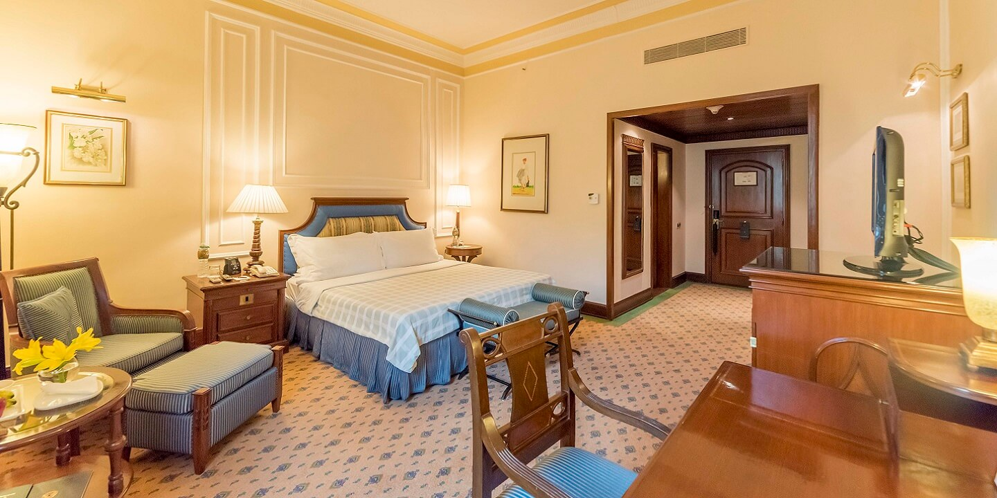 Luxury hotel room the oberoi grand kolkata five star for Luxury accommodation worldwide