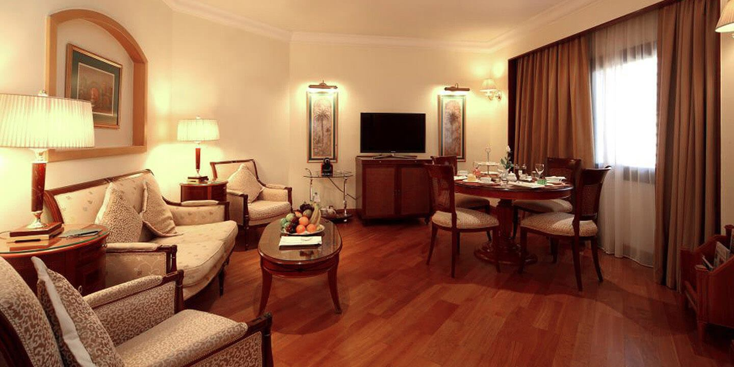 Executive Suites With Twin Bedroom, Living Space & Dining at The Oberoi, Madina