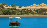 Shikara Ride in The Traditional boat on Lake Pichola in Udaipur - The Oberoi Udaivilas