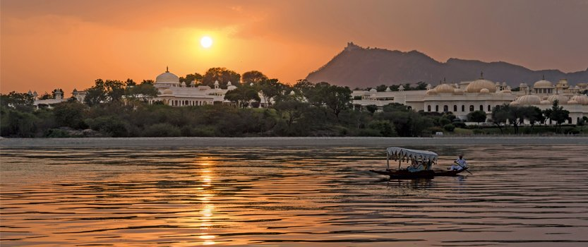Sunset Boat Ride on Lake Pichola, The Traditional boat on Lake Pichola in Udaipur - The Oberoi Udaivilas